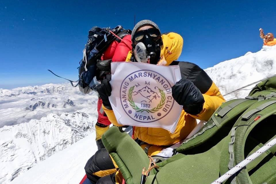 Mountaineers Take MMC Flag To Top Of The World